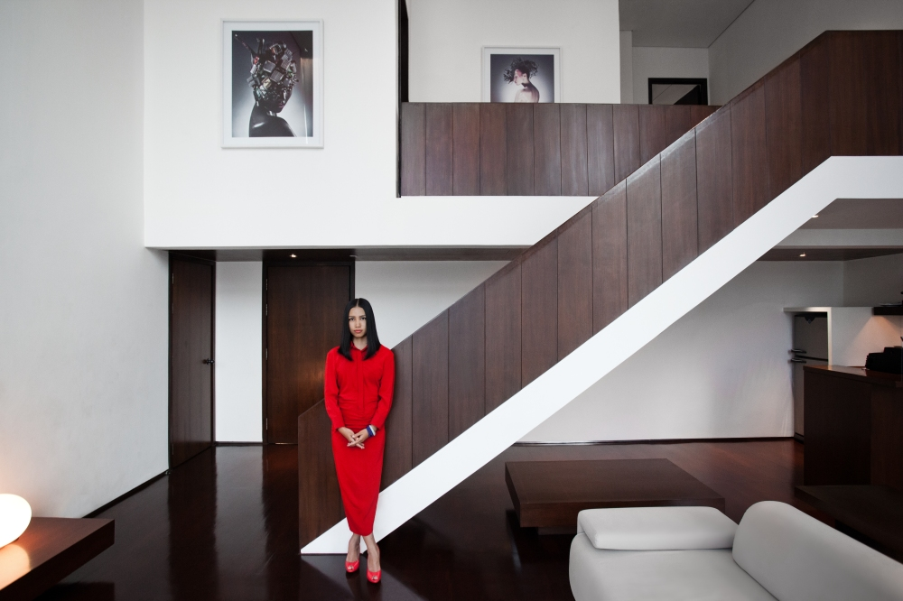 Chen Man in the suite 1119 of Metropolitan by COMO, Bangkok, with some of her works. © Inga Beckmann